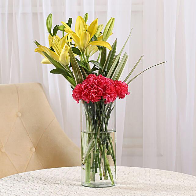 Orange Delight - Glass Vase arrangement of 6 orange carnations and 2 yellow lilies.