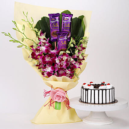 Online Dairy Milk & Orchids With Black Forest Cake