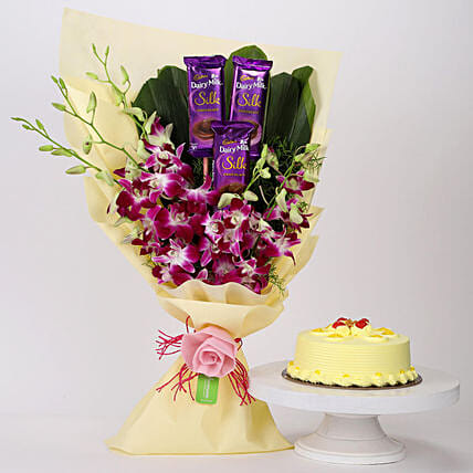 Online Dairy Milk & Orchids Bouquet with Butterscotch Cake