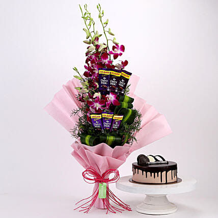 Online Dairy Milk Orchids Bouquet And Chocolate Cake:Cakes and Chocolates