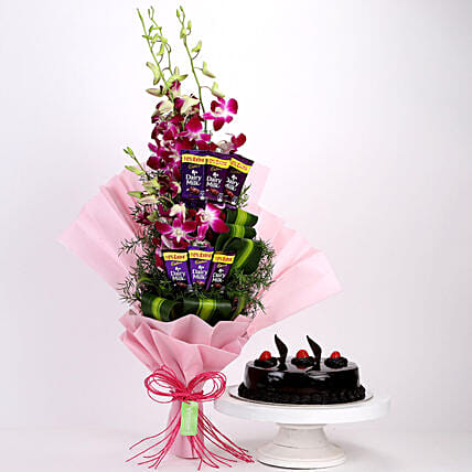 Online Dairy Milk Orchids Bouquet And Truffle Cake:Cakes and Chocolates