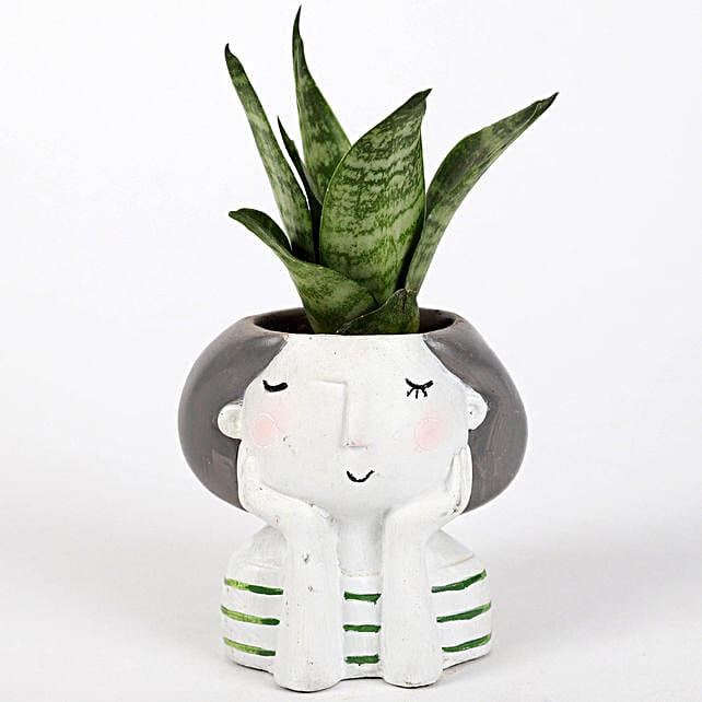 sansevieria plant in custom girl shape pot