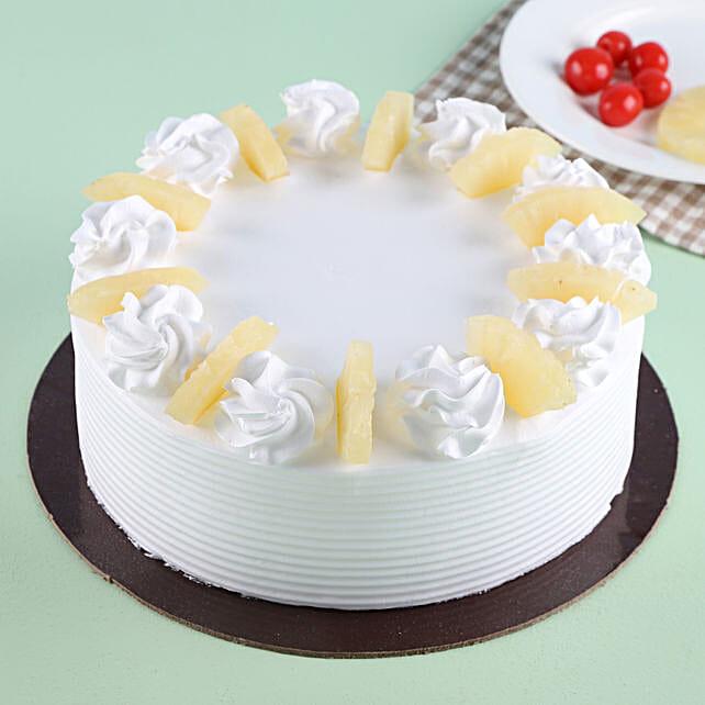 Pineapple Round Cake Half kg:Send Pineapple Cakes