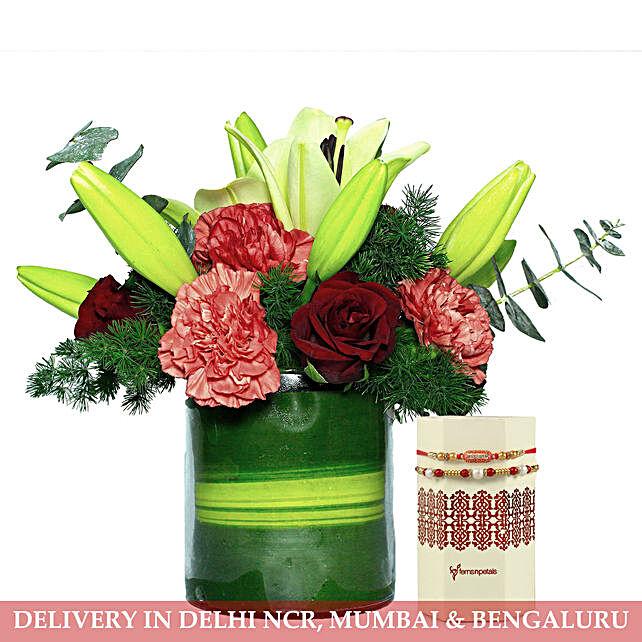 Carnations Roses Lilies Arrangement With Rakhi Set