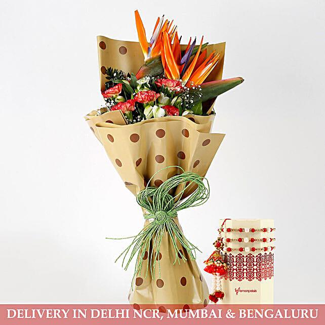Carnations Orange Bird of Paradise Bouquet With Lumba Rakhi Set