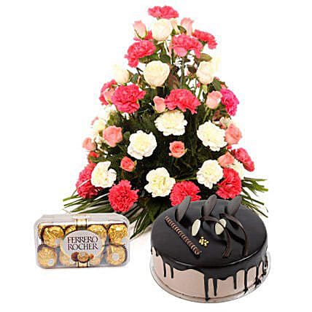 Bright Hues Hamper - Basket arrangement of 40 mix colour flowers, 200gms ferrero rocher and half kg chocolate cake.