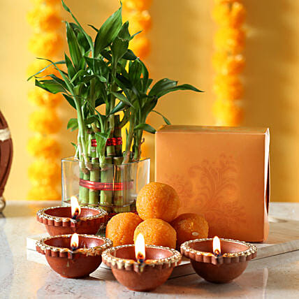 Lucky bamboo with diyas and sweets