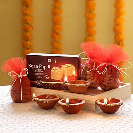 Dry fruits, sweets and a greeting card