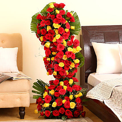 Endless Love - 3-4 ft high arrangement of 100 red and yellow roses.