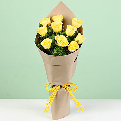 Bright Yellow Roses In Brown Paper