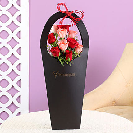 Red Pink Roses In Sleeve Bag