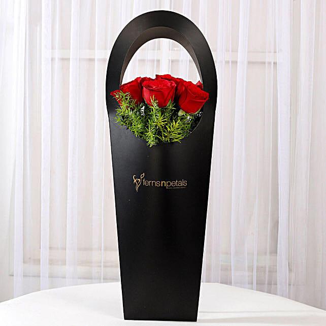 Ravishing 12 Red Roses in Black Sleeve