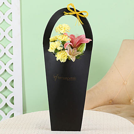 Yellow Carnations Lilies In Sleeve Bag