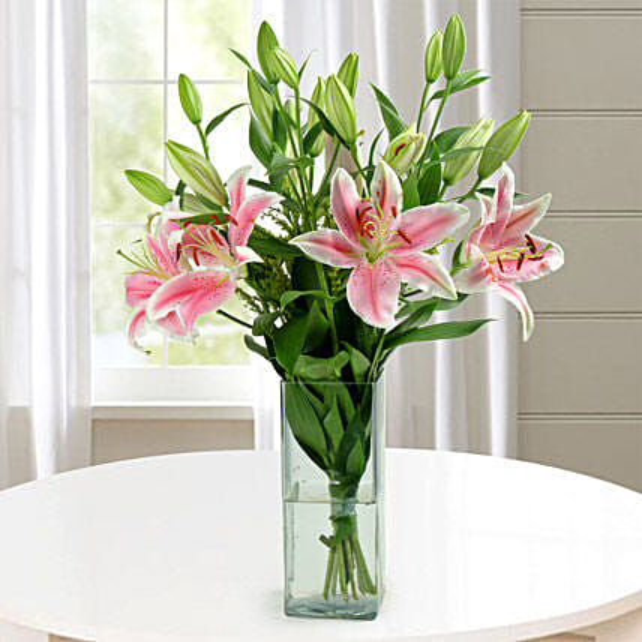 Square glass vase arrangement of oriental lilies