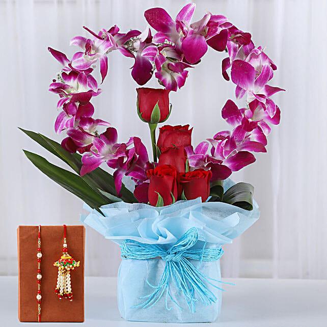 Flower Arrangment and Rakhi for Bhaiya Bhabhi