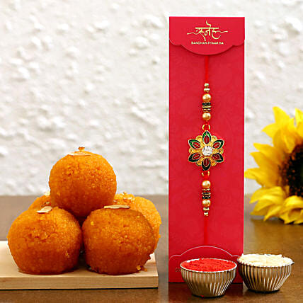 celebrate raksha bandhan with rakhi and sweet