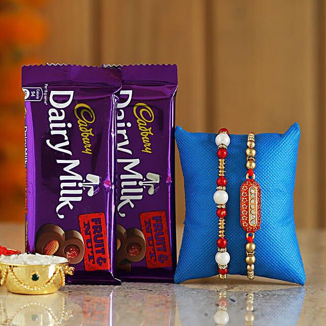 trendy rakhi with cadbury fruit n nut combo online:Send Rakhi to Akola