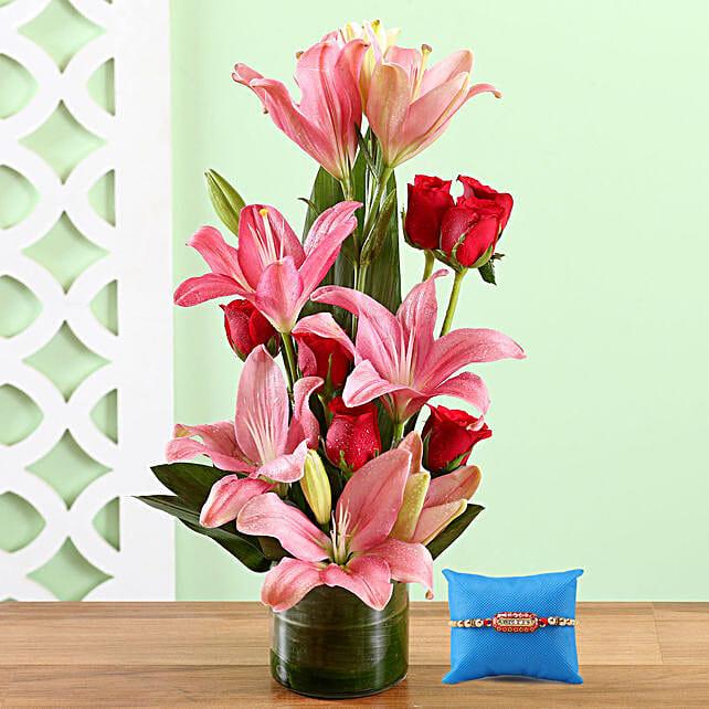 Vase Of Lovely Blooms & Capsule Rakhi
