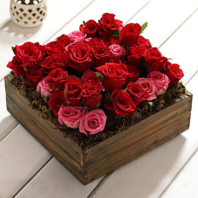 flower in wooden tray arrangement