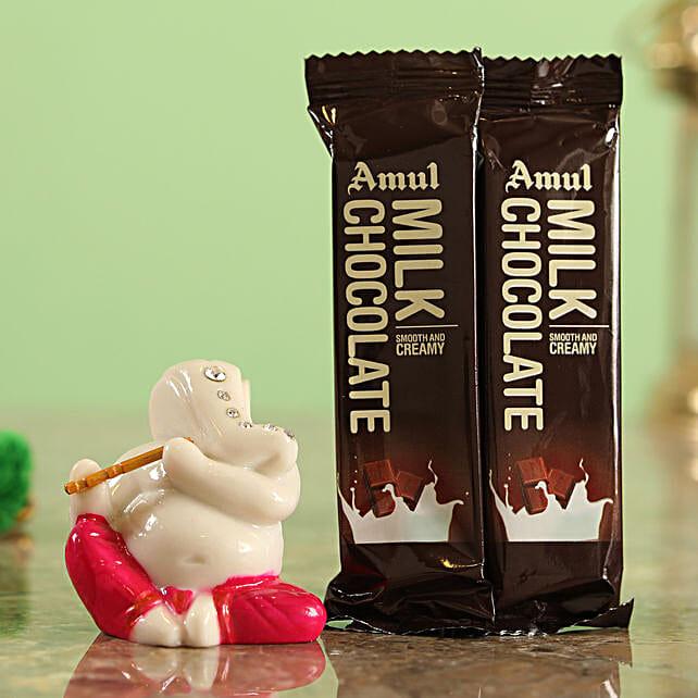 Amul Flowwrap Chocolates & Magenta Ganesha Idol Combo  Online