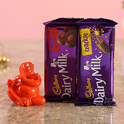 Online Dairy Milk Choco Combo & Festive Orange Ganesha Idol:Send Cadbury Chocolates