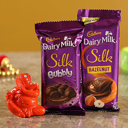 Dairy Milk Silk Hazelnut Bubbly Combo & Orange Ganesha Idol  Online