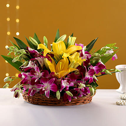 Timeless Elegance - Basket arrangement of 6 Purple Orchids with 2 yellow lilies.