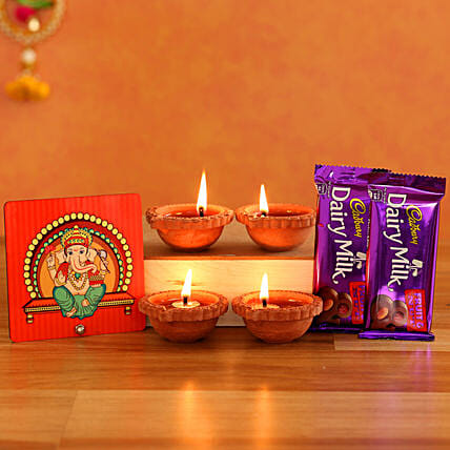 Cute Ganesha Table Top With Cadbury Fruit N Nut Diyas
