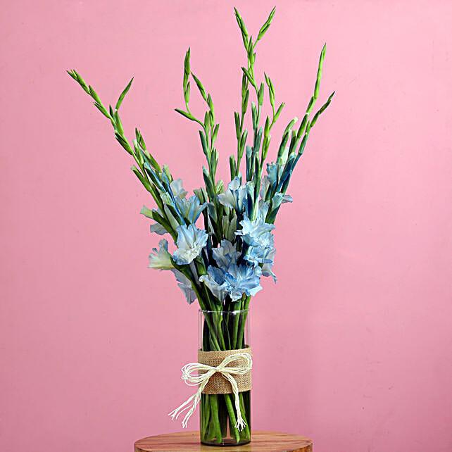 blue glads in cylindrical vase