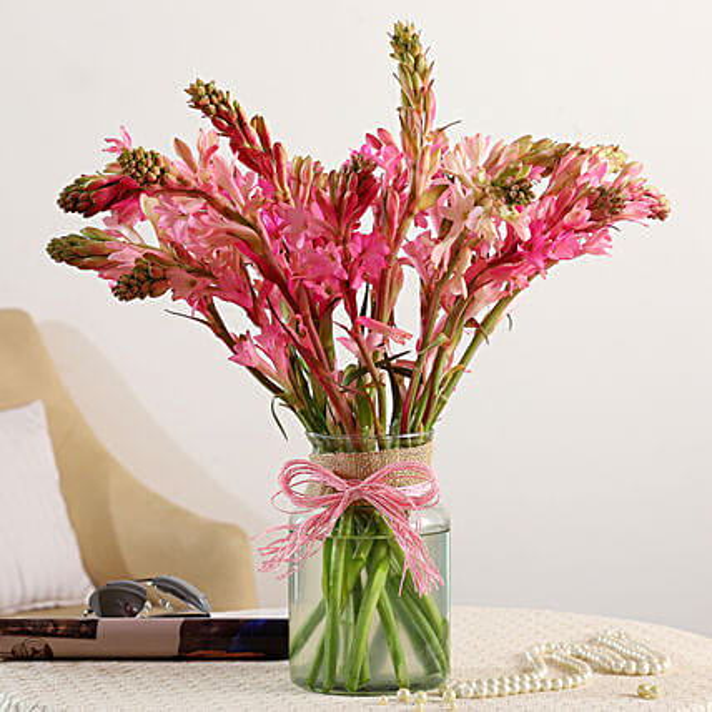 bunch of tube roses in jar vase