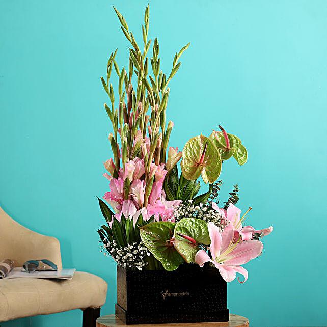 mixed flowers arrangement:Anthuriums