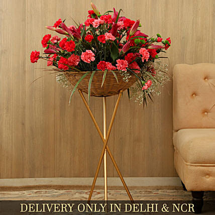 Elegant Bunch Of Flowers In Basket With Iron Stand