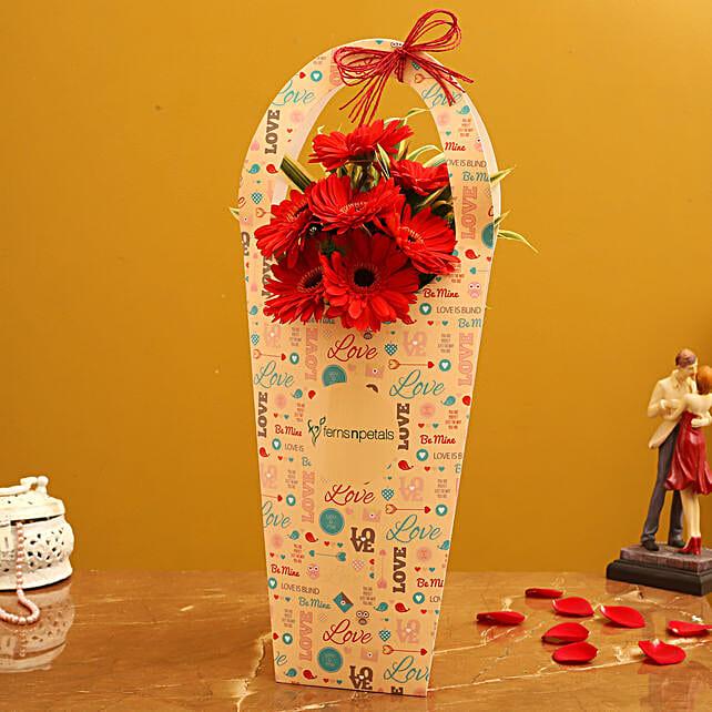 Red Gerberas In FNP Love Sleeve