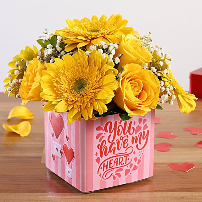 yellow rose in vase arrangement for vday