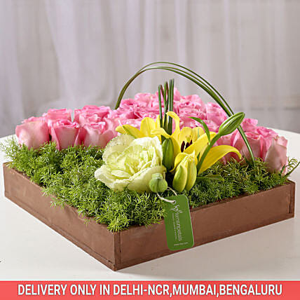 flower paradise in wooden tray