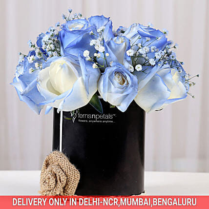 blue roses arrangement in black box:Wedding Flowers