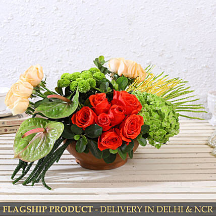 Appealing Mixed Flowers In Textured Terracotta Pot
