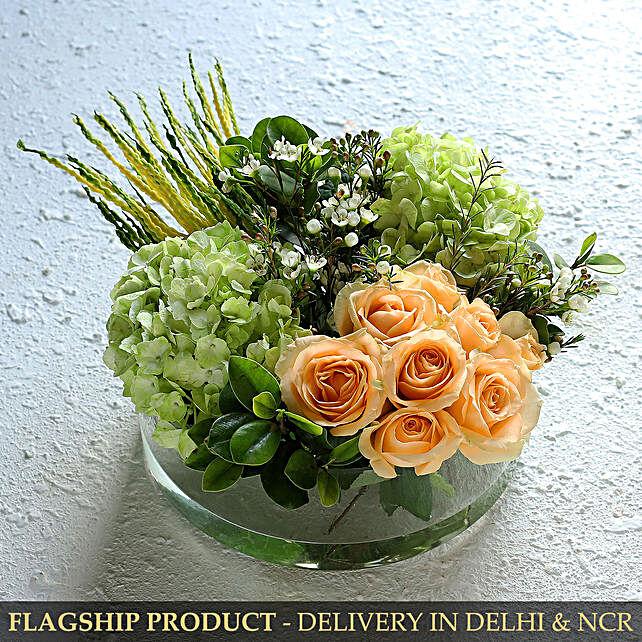 Elegant Mixed Flowers In Thali Glass Vase