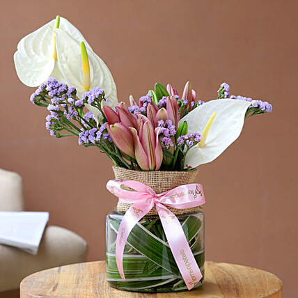 Charming Mixed Flowers In Pink Ribbon Tied Jar