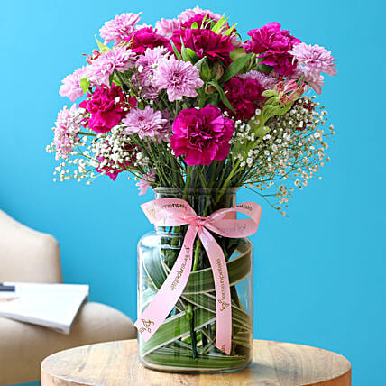 Colourful Mixed Flowers In Pink Ribbon Tied Jar