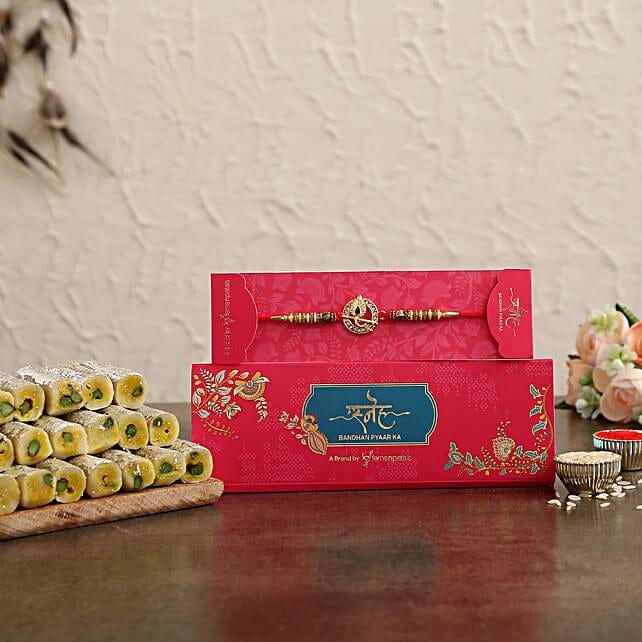 Krishna Pure Look Rakhi N Kaju Rolls Hamper:Rakhi With Premium Sweets