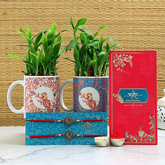Peacock Rakhis N Two Layer Bamboo Set In Mugs
