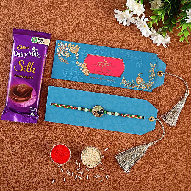 Striking Peacock Rakhi And Chocolates:Peacock Rakhi