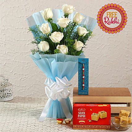 Free Pearl Rakhi With White Roses Bunch and Soan Papdi:Rakhi with Flowers