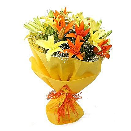 Color Me Up - Bunch of 8 yellow and orange asiatic lilies in dual paper packing.