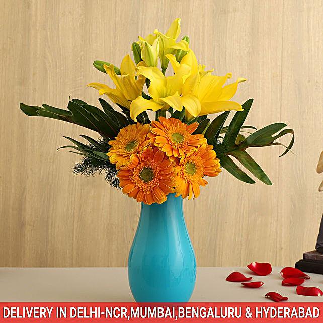 flower in blue glass vase