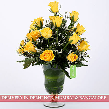 yellow roses in attractive vase arrangement