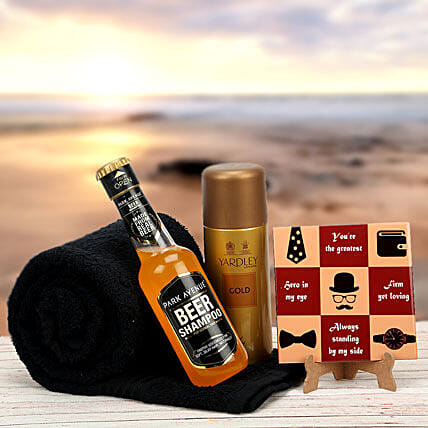 Gift hamper of table top, beer, body spray and towel