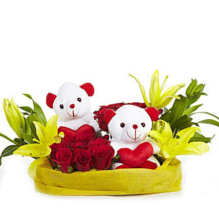 You N Me - Basket arrangement of 12 Red roses with 2 cute soft toys, 2 yellow Asiatic lilies wrapped in paper packing.:Flower Basket Arrangements