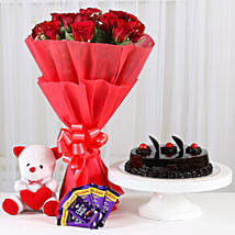 Sweet Combo For Sweetheart - Bunch of 15 Red Roses in paper packing With 6inch Soft toy, 500gm Truffle Cake & 5 cadbury chocolate (14gm each).